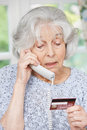Senior Woman Giving Credit Card Details On The Phone Royalty Free Stock Photos - 55691368
