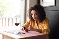 Woman With Smartphone In Restaurant Royalty Free Stock Photo - 55695085