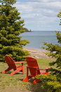 Two Red Adirondack Chair Stock Photography - 5570462