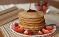 Stack Of Sweet Pancakes With Strawberries And Syrup Royalty Free Stock Photo - 55715475