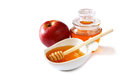 Rosh Hashanah (jewesh Holiday) Concept - Honey And Red Apple Isolated On White. Traditional Holiday Symbols. Stock Photos - 55723993