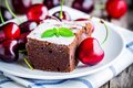 A Piece Of Homemade Chocolate Brownie Dessert With A Cherry Royalty Free Stock Image - 55734046