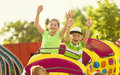 Boy And Girl On A Thrilling Roller Coaster Ride At An Amusement Park Stock Photos - 55752233