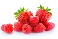 Heap Of Sweet Strawberries And Juicy Raspberries  On White Background. Summer Healthy Food Concept Royalty Free Stock Photo - 55757155