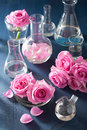 Alchemy And Aromatherapy Set With Rose Flowers And Chemical Flas Stock Images - 55761694