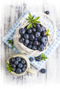 Blueberry Basket And Jug On White Wooden Table Royalty Free Stock Photos - 55770938
