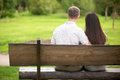 Couple On Park Bench Stock Photo - 55778720