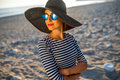 Woman In Stripped Dress With A Hat On The Beach Stock Photos - 55786853