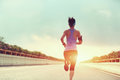 Young Woman Runner Running On City Royalty Free Stock Photo - 55787415