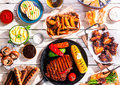 Barbequed Meats And Vegetables On Picnic Table Royalty Free Stock Photo - 55789435