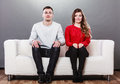 Shy Woman And Man Sitting On Sofa. First Date. Stock Photo - 55791310