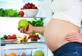Nutrition And Diet During Pregnancy. Pregnant Woman With Fruits Royalty Free Stock Image - 55798836