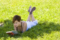 Blonde Reading At Park Stock Image - 5580871