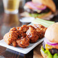 Barbecue Boneless Wings And Hamburgers Stock Photography - 55804922