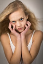 Beautiful Teenage Girl Hair In The Wind Hands On Face Stock Images - 55808414