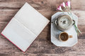 Tea Cups With Teapot With Open Book On Old Wooden Table. Royalty Free Stock Images - 55832239