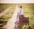 Beautiful Girl On Suitcase With Flowers Royalty Free Stock Images - 55836189