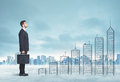 Business Man Climbing Up On Hand Drawn Buildings In City Stock Images - 55838924