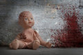 Concept Of Child Abuse - Bloody Doll Royalty Free Stock Photos - 55839128