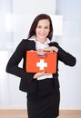 Businesswoman Holding First Aid Box Stock Photo - 55849280