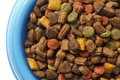 Dry Cat Food In Blue Bowl, Detail On White From Above. Royalty Free Stock Photos - 55863438