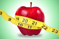 Red Apple And Measuring Tape Royalty Free Stock Photo - 55873735
