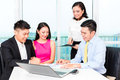 Asian Banker Team Counseling Couple In Office Stock Image - 55885511