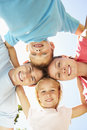 Close Up Of Family Group Looking Down Into Camera In Park Royalty Free Stock Photos - 55890088