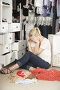 Unhappy Teenage Girl Unable To Find Suitable Outfit In Wardrobe Stock Photos - 55895603