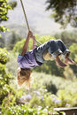 Young Boy Having Fun On Rope Swing Stock Photography - 55896242