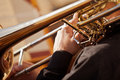 Fragment Of The Trombone In The Hands Of The Musician Stock Photo - 55940600