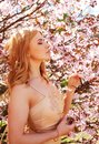 Young Blond Girl In Spring Flowers Garden Stock Photos - 55944413