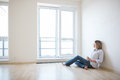 Just Moved In: Beautiful Young Woman Finally Sitting Down Stock Photography - 55958442