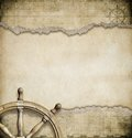 Old Steering Wheel And Torn Nautical Map Stock Photo - 55964360
