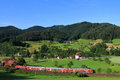 Red Train In Black Forest Landscape Stock Photo - 55974980
