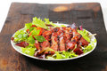 Grilled Pork Meat With Salad Greens Stock Photo - 55975690