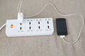 Mobile Phone Is Charging On Power Cord Royalty Free Stock Images - 55981449