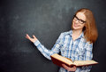 Happy Girl Student With Glasses And Book From Blank Blackboard Stock Images - 55983364