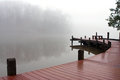 Thick Fog Covers Wooden Dock And Lake On Winter Day Royalty Free Stock Photo - 55983425