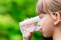 Girl Drinking Glass Of Fresh Water Royalty Free Stock Images - 55989569