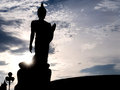 Silhouette Walking Buddha Statue With Sunlight Flare Royalty Free Stock Images - 56002909