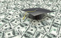 Mini Graduation Cap On US Money - Education Costs Royalty Free Stock Image - 56008876