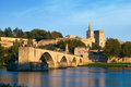 Avignon Bridge With Popes Palace And Rhone River At Sunrise Stock Photos - 56011183