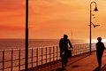 Riding Along Jetty At Sunset To Go Fishing Royalty Free Stock Photos - 56032288
