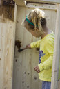Girl Staining The Wood Royalty Free Stock Image - 56036396