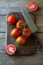 Tomatoes On The Old Cutting Board Royalty Free Stock Photo - 56051515