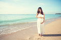 Happy Asian Pregnant Woman Smile While Touching Her Tummy On The Stock Photography - 56095652