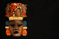 Indian Mayan Aztec Wooden Carved Painted Mask Isolated On Black Royalty Free Stock Image - 56105076