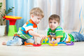 Children Playing Rail Road Toy In Nursery Stock Photos - 56118763