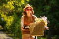 Pretty Young Woman With Bicycle In The Park Stock Image - 56192691